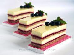 Raspberry Rose Vanilla Bavarian Cream Cake: 1. Almond Rose Dacquoise,  2.  Raspberry Layers/Jelly, 3. Vanilla Bavarian Cream, 4. Lemon Glaze.