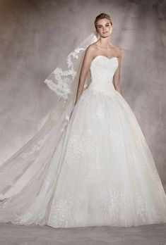Stunning strapless dipped neckline ballgown wedding dress with floral embroidered tulle skirt; Featured Dress: Pronovias