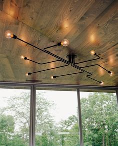 UrbanLab designed the circuit board–like lighting fixtures in the living area.