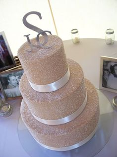 """""""Sugar & Mocha"""", 14"""" was chocolate rush cake filled with raspberry, 10"""" & 6"""" were butter pecan cake filled with cream cheese. Sugared mocha buttercream over all. Real ribbon. Served 128. Wedding & reception were held at Gervasi Vineyard in Canton."""