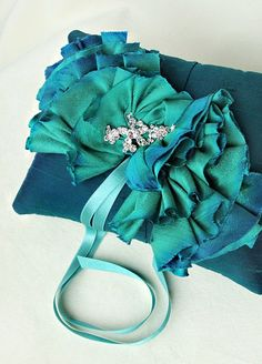 such a pretty teal color! love the ruffles.