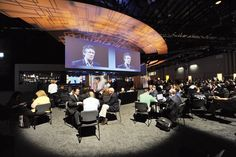 Great idea - SAP's 2011 Sapphire Now conference in Orlando created a networking lounge on the show floor where attendees could view the keynote addresses on 18- by 60-foot screens while getting work done. Photo: Randy Belice/SAP AG