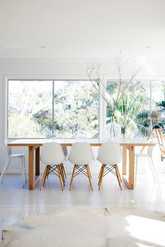 Fur rugs with white Eames chairs are perfect for any room (especially a dining room) / table + cream cowhide | sfgirlbybay