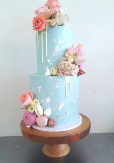 Two tiers of pastel blue with a white drip. Silver leaf, donuts, meringues, macarons, chocolates and Drip Cakes, Blue Drip Cake, Two Tier Cake, Funny Cake, Blue Cakes, Cupcakes, New Cake, Cake Mix Recipes, Cake Decorating Techniques