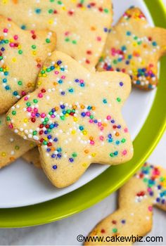 Easy cut out FUNFETTI SUGAR COOKIES recipe from scratch. Crispy, crunchy and packed with sprinkles. No chilling required and they don't spread! From cakewhiz.com