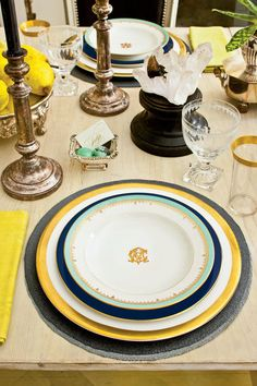 Give It Some Edge - How To Set a Stunning Table - Southernliving. Balance a whitewashed table with graphic hits of black and navy, such as black candles and leather chairs, slate-gray woven place mats, and navy-rimmed dinner plates.  How To Set this Refined Traditional Table
