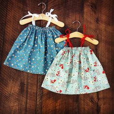 This whimsical dress is available in your choice of fabrics, choose from Tiny Mushrooms or Forest Critters. Elastic at the chest, and ribbon ties