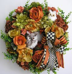 """The wreath is embellished with beautiful brunt orange Peonies, orange Peonies, apple green Dahlias, orange/yellow Roses,and light green, dark green, brown,orange Hydrangeas. The wreath is accented with a very cute brown and white Owl, and a small white Owl. I finish the wreath with a high-end black/white checker and orange/brunt orange Ribbon Bow.  The wreath measures from tip to tip at 22"""" (L) x 21"""" (W) x 6.5""""(D)."""