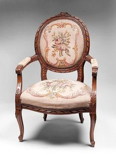 """FauteuilChair  Fauteuil (pronounced foe-toy) literally translates to """"armchair""""It specifically means an upholstered armchair with open sides. Developed in the late 1600s in France, towards the end of Louis XIV's reign, remained quite popular in 18th century. The style not only became lighter and more graceful  but also more ornate - the chair arms were many times upholstered to match back & seat.  Variations include the fauteuil à la reine (Queen's armchair), which has a square, high back"""