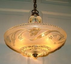 "Nice. A commentor says: ""For your information, this is a Porcelier chandelier and these were distributed by Harmony House (Sears). Porcelier is also a fun collectible since the company made scads of light fixtures..."""