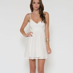 """""""Snow"""" Fit & Flare White Dress Flare white mini dress. So very sexy. Brand new. Bare Anthology Dresses"""