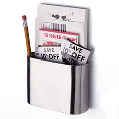 Magnetic Memo Holder ($10.99) - holds notes, scraps of paper, writing utensils & more; keep track of important info by keeping messages & notes within reach in 1 organized place; features chrome finish that is rust resistant & strong magnetic backing; comes w/ memo pad & pen;
