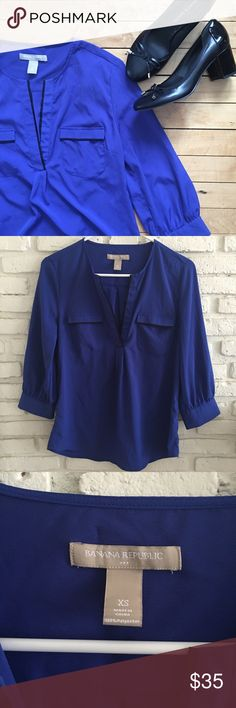 Banana Republic Blouse Beautiful cobalt blue Banana Republic top with black lining. Perfect for the office or internships. A roomy XS that would likely fit a size Small as well. 100% polyester. Worn once. Color accurately portrayed in first picture. Shoes available in separate listing. Low ballers will be ignored. No trades please. Banana Republic Tops Blouses