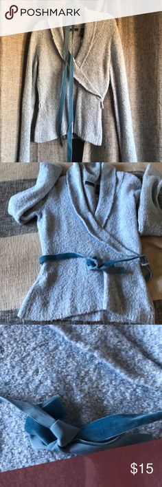Gorgeous belted baby blue sweater Softest baby blue sweater with velvet belt to wrap around and get in a bow. Classic to dress up or down. Originally from Victoria's Secret catalog. Moda International Sweaters Crew & Scoop Necks
