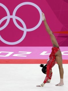 During the women's gymnastics team final of the London Olympics, U.S. gymnast Gabby Douglas competes on the floor exercise.