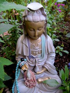 Kuan Yin is synonymous of mercy, compassion, kindness and love.     She is usually shown in a white flowing robe - white being the symbol of purity. She holds a jar with Sacred water, symbol of good fortune. Water is also the divine nectar of life, compassion and wisdom.