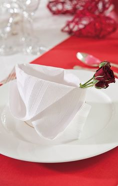 An elegant folded napkin to set the romantic tone