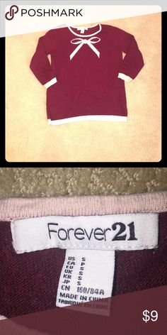 Forever 21 quarter length sleeve sweater On arm length it comes right above the elbow. It is a women's small, but would fit a extra small also.I sadly out grew this, but I hope someone will make a better home for it. Forever 21 Sweaters Crew & Scoop Necks