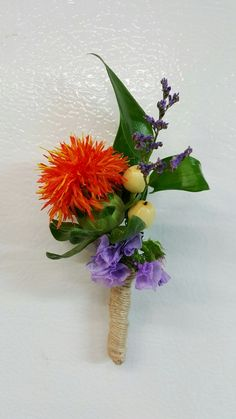 Orange safflower groomsman boutonniere with purple statice and limonium, ruscus and hypericuml with jute ribbon wrap from Seasonal Celebrations.