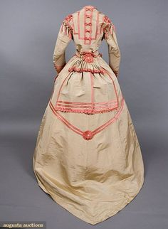 Back view of French silk visiting  dress (1860s) with coral satin bands, scallops, bows, rosettes, and Van  Dyke points; from the Tasha Tudor Historic Costume Collection