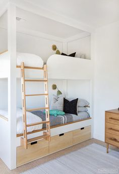 These built in Bunk Beds are a great option because they allow for pullout drawers to fit underneath, allowing for extra storage. (Designed by Amber Interiors).