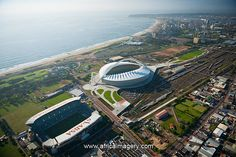 Durban, South Africa Amazing aerial view of Moses Mabhida Stadium & Absa Stadium in the foreground.wiith the beautiful ocean in the back Beautiful Ocean, Aerial View, Cool Places To Visit, South Africa, The Good Place, Birth, Around The Worlds, Entertainment, Spaces