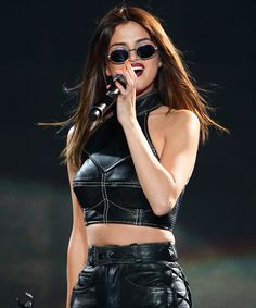 See All 5 of Selena Gomez's Dazzling Revival Tour Outfits - Singapore Bonus: Act 1 from InStyle.com