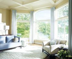 Window treatment ideas for bay windows that are modern, don't block the view, and let in natural light.