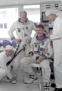 Walter Schirra and Thomas Stafford preparing for space flight in 1965