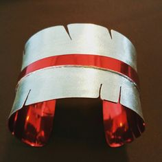 Xlg. Feather Cuff, Matte finish with Red Ceramic Coating. Michael and Elizabeth Kirk, Isleta Pueblo, NM. $650.00