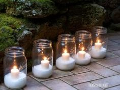 Candles resting on Epsom salt in a Mason jar – found at http://theinspiredroom.net/2009/11/30/easy-diy-christmas-decorating-idea-glittery-ep...