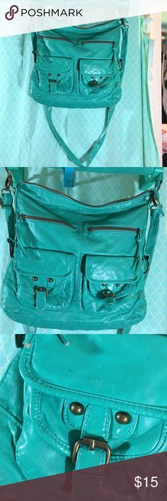 6 pocket turquoise cross-body purse 6 pocket turquoise cross-body purse. Used purse with a few signs of wear: ink spots on he exterior and exterior of the purse and pills on the interior. Still a great purse with lots of life left in it! Bags Crossbody Bags