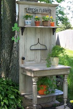 My husband & a friend constructed this from an old door, half a table and the metal part of a rack.  It makes a nice accent in the corner of our yard between two flower beds.