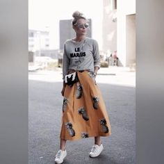 A grey print crew-neck jumper and an orange print full skirt are your go-to outfit for lazy days. Polish off the ensemble with white low-top sneakers.  Elevate your getup with Shoe String King unique shoelaces. Grab a pair of our strings at www.ShoeStringKing.com!  #SSKfemale #white #sneakers #skirt #stylish #model #woman #shoes #shoeporn #shoegasm #instashoes #instastyle #instafashion #street #style #chic #spring #instapic #instagood #ootd #lookoftheday #shoelover #sneakerheads #shoelaces