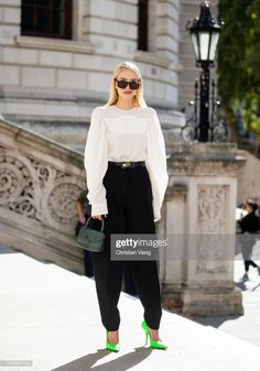 Leonie Hanne seen wearing black high waist pants, creme white top,. Fashion Pictures, Style Pictures, Leonie Hanne, Wide Trousers, Green Heels, Wearing Black, London Fashion, White Tops, Victoria Beckham