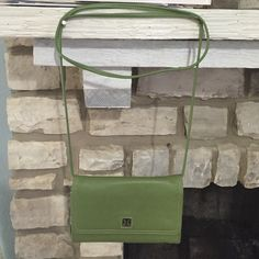 NWT Giani Bernini crossbody PLEASE NOTE: this item is NWT, never used but has scratches on the bottom corners as shown in picture 4. This crossbody is spacious and acts as a wallet as well. Comes with an extra little card holder. Cheaper on merrc. Giani Bernini Bags Crossbody Bags