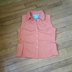 Tommy Hilfiger Casual Top This is a capped sleeve front button Tommy Hilfiger top. It's a soft orange color and a comfortable size 8. Tommy Hilfiger Tops
