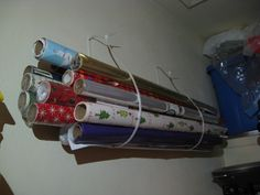 Here's a great way to store wrapping paper. I bought extra-long zip-strips at a hardware store, my husband nailed them to the wall of a storage closet. Voila! They are out of the way until we need them, and easily accessible.
