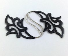 Black copper earrings with arabesque floral pattern by Gracebourne, $58.00