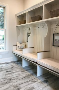 artisan home tour cottage-inspired mudroom with gray walls, shiplap, cubbies, and rustic gray flooring