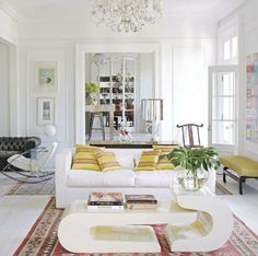 White room with colorful textiles.