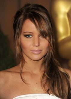 This caramel toned Light Brown Golden haircolor on Jennifer Lawrence is a lovely in-between shade that complements her skin. Get your own most flattering #hair #color blended just for you at home here: http://www.haircolorforwomen.com/breakthrough-hair-color-system-your-salon-doesnt-want-you-to-know-about-p/