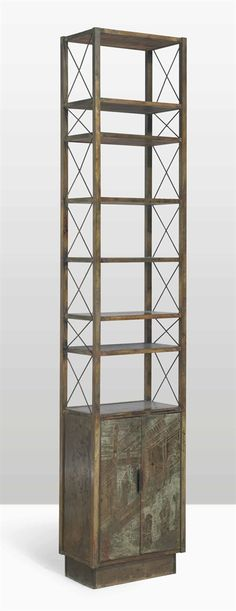 PHILIP (1908-1988) AND KELVIN (B. 1936) LAVERNE A 'CHAN' BOOKCASE, CIRCA 1970 patinated bronze with pewter and enamel 95½ in. (242.6 cm.) high, 19 in. (48.3 cm.) wide, 12 in. (30.5 cm.) deep front door signed Philip + Kelvin LaVerne
