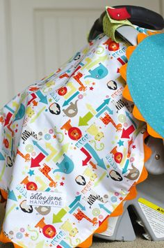 Car seat canopy. I love the jumbo ric-rac detail.  I made one for my baby with a cool robot fabric--super easy!