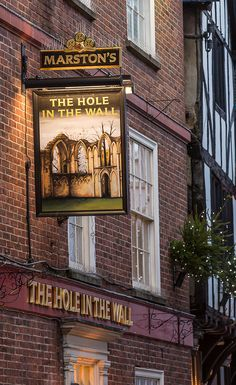 This pub is haunted by footsteps. It is the Hole in the Wall, York, England. Located just 50 meters from York Minster it is a good stop for pub lunch while exploring the old city. York England, British Pub, British Isles, Yorkshire, Uk Pub, Best Pubs, Pub Signs, Pub Crawl, Big Ben London