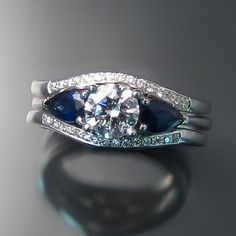 STUNNING! Custom made diamond wedding bands fitted to  diamond and blue sapphire engagement ring