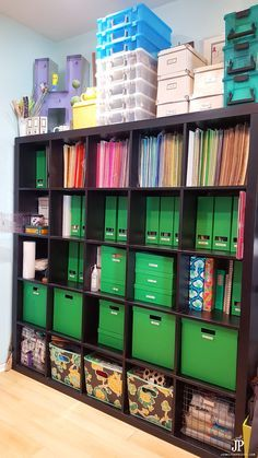 Store paper, embellishments, and craft supplies in IKEA expedit or IKEA kallax bookcase. This room by Jennifer Priest has some great ideas!