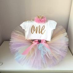 Lavender and Gold First Birthday Tutu Set (3-piece set) This first birthday outfit is a soft and elegant outfit for your little girl Tutu sizes 6 - 12 Months Waist: 15/16 Lenght: 7/8 12 - 18 Months Waist: 16/17 Lenght: 7/8 HEADBAND SIZES 6-12 Months:16 12-18 Months: 17