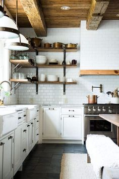 Rustic kitchen cabinet is a lovely mix of country home and farmhouse decoration. Discover rustic kitchen closet styles, plus browse inspiring images Rustic Kitchen Cabinets, Farmhouse Kitchen Decor, Slate Kitchen, Modern Farmhouse, Farmhouse Interior, Dark Cabinets, Farmhouse Style, Inset Cabinets, Kitchen White