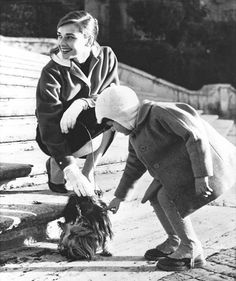 Audrey Hepburn and her dog, Mr. Famous, meet a little boy on the Spanish Steps in Rome, april 1958.